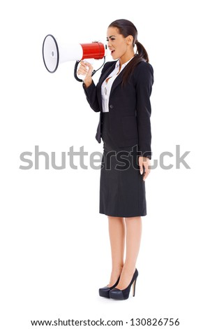Cute business woman screaming loudly through big megaphone