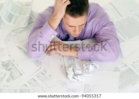 cute businessman with a lot of papers - stock photo