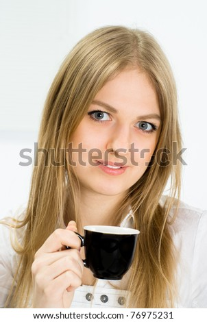 cute businesswoman with a black cup on white - stock photo