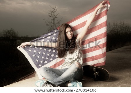 Cute casual girl holding stars and stripes behind her head toned image instagram color - stock photo