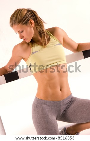 Cute caucasian athletic model with barrier - stock photo