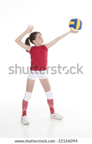 Cute Caucasian girl serving the ball in volleyball - stock photo