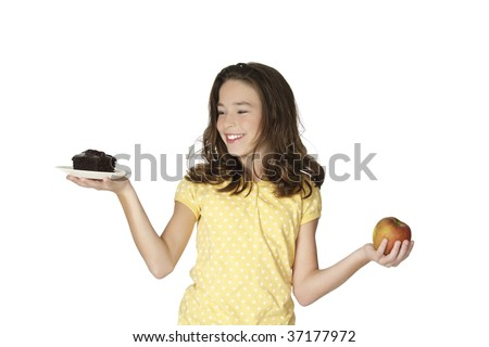 Cute Caucasian girl trying to make a decision between eating healthy or not - stock photo