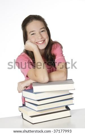 Cute Caucasian girl working on homework - stock photo