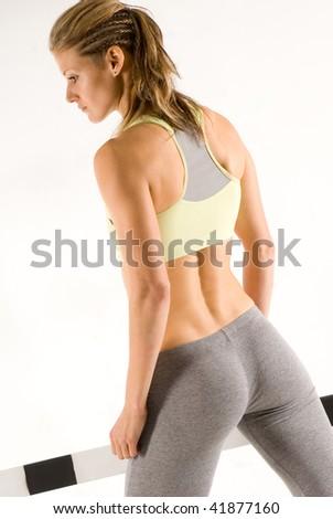 Cute caucasian sportive model with hurdle - stock photo