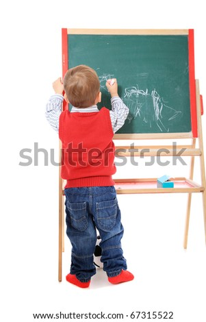 Cute caucasian toddler doodling. All isolated on white background.