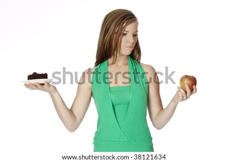 Cute Caucasian woman trying to make a decision between eating healthy or not - stock photo