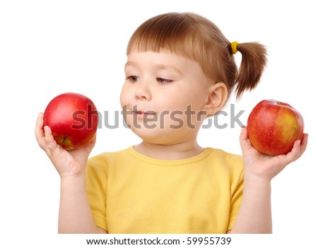 Cute cheerful child choose between two red apples, isolated over white - stock photo