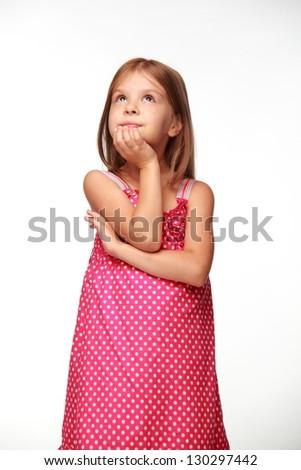 Cute cheerful child in a beautiful dress - stock photo