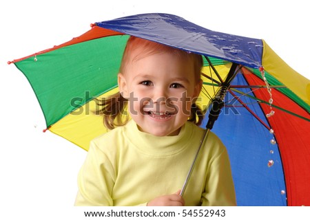 Cute cheerful child with colorful umbrella is catching raindrops, isolated over white