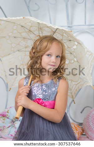 Cute cheerful child with umbrella. - stock photo