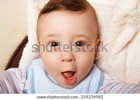 Cute cheerful  little baby boy. - stock photo