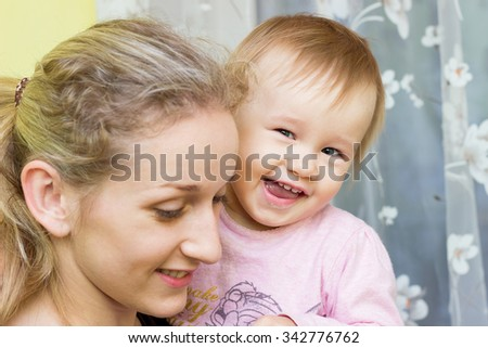 Cute cheerful little girl, Small baby with mother - stock photo