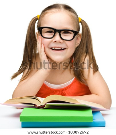 Cute cheerful little girl with books wearing glasses, isolated over white - stock photo