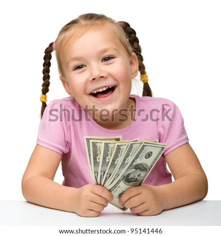 Cute cheerful little girl with paper money - dollars, isolated over white - stock photo