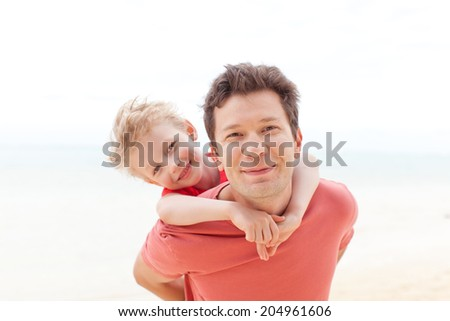 cute child and his father spending fun time together - stock photo
