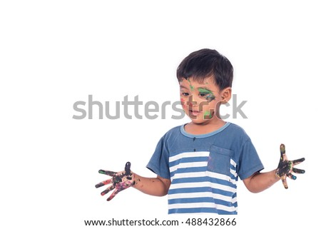 Cute child asian little boy playing water color and paint on face