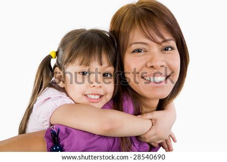 Cute child embracing her beautiful mother and both looking at camera with smiles - stock photo