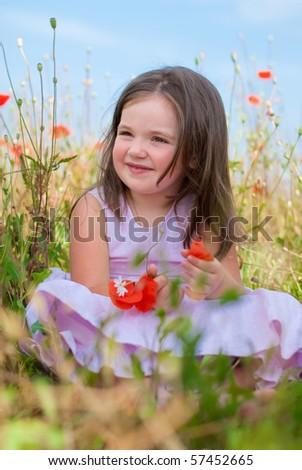 Cute child girl in poppy field - stock photo