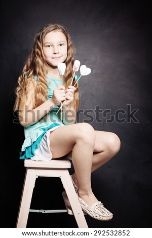 Cute Child Girl. Portrait on dark background - stock photo