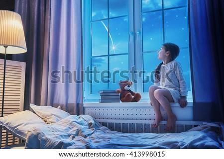Cute Child Girl Sitting Window Looking Stock Photo