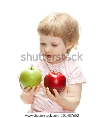 Cute child holding apples looking and them, isolated on white - stock photo