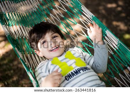 Cute child in hammock - stock photo