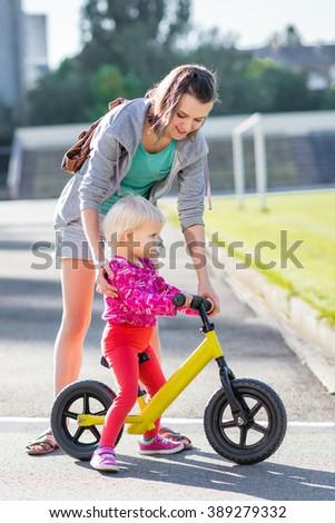 Cute child rides a balance bike - stock photo