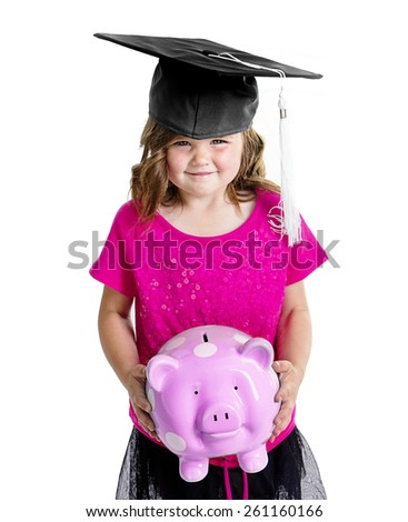 Cute Child Saving for College with her piggy bank - stock photo