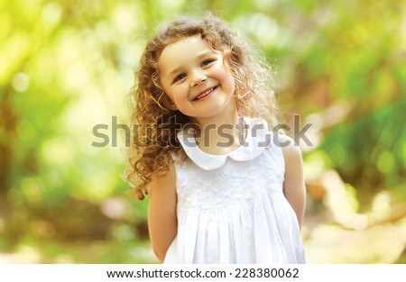 Cute child shone with happiness, curly hair, charming smile  - stock photo