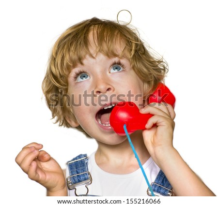 Cute child with a red phone  - stock photo