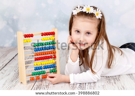 Cute child with abacus - stock photo