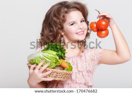 Cute Child with vegetables, Gardening. Lovely little girl with basket of ecological harvests, Kid with healthy food. studio, isolated on white background.