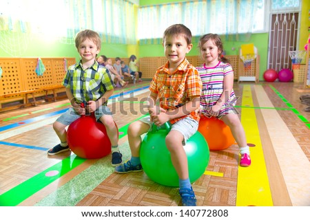 Cute children playing in kindergarten gym