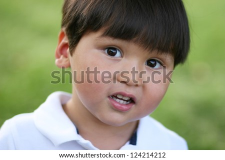 Cute chubby cheeked boy caught looking surprised - stock photo