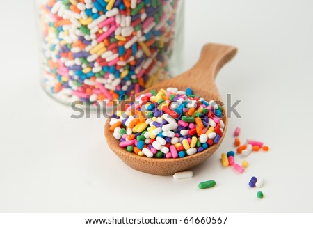 Cute Colorful  Sprinkles for Dessert Decorating on a Bamboo Spoon - stock photo