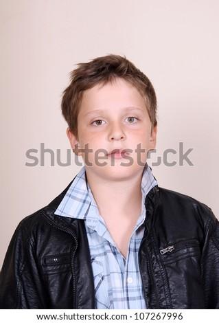 Cute cool boy in black jacket - stock photo