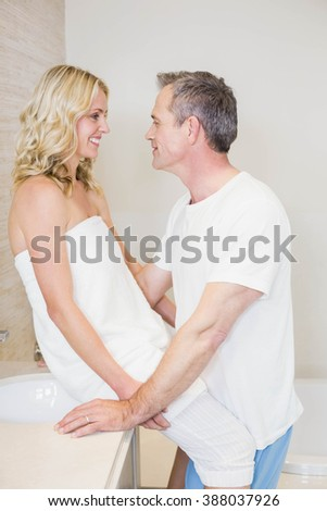 Cute couple about to kiss in the bathroom