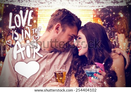 Cute couple drinking against love is in the air - stock photo