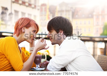 Cute couple eating lunch - stock photo