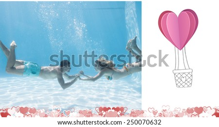 Cute couple holding hands underwater in the swimming pool against heart hot air balloon - stock photo