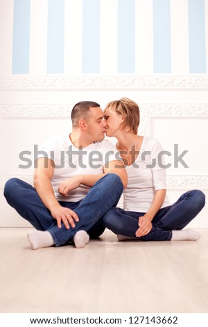 Cute couple in love hugs at home