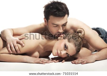Cute couple lying on the floor - stock photo