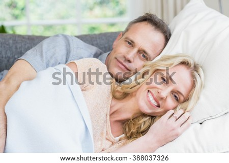 Cute couple napping on the couch in the living room