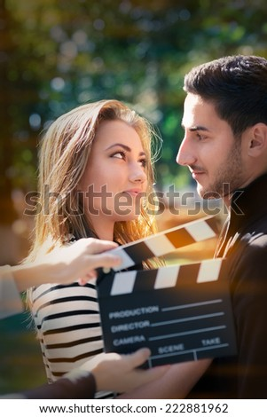 Cute Couple Ready for a Shoot - Young couple shooting a romantic scene outside - stock photo