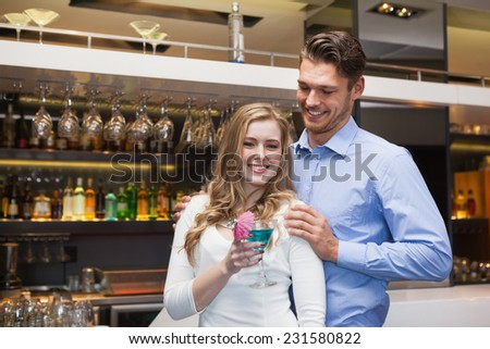 Cute couple standing and laughing together at the nightclub