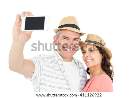 Cute couple taking selfie over white background - stock photo