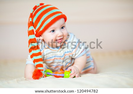 cute crawling baby boy playing indoors - stock photo