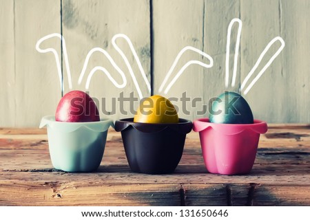 Cute creative photo with easter eggs in the nest - stock photo