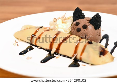 Cute crepe with banana and chocolate